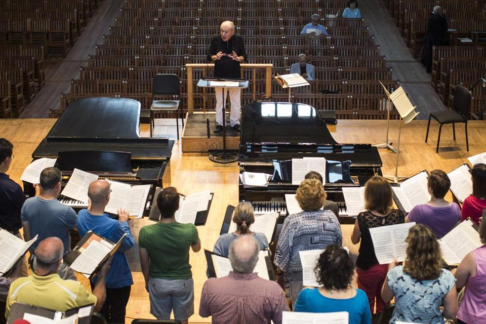 Oliver, founding director of the Tanglewood Festival Chorus, leads a rehersal in Seiji Ozawa Hall in Lenox Tuesday.